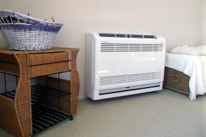 ductless-heat-pump-air-handler-on-floor