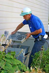 technician-servicing-air-conditioner