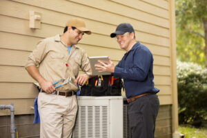 technicians-working-on-air-conditioner