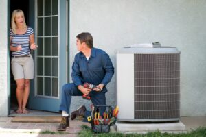 tech-working-on-central-ac-outdoor-unit