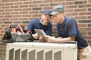 two-techs-working-on-ac-system