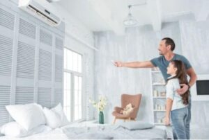 man-and-daughter-looking-at-ductless-air-handler